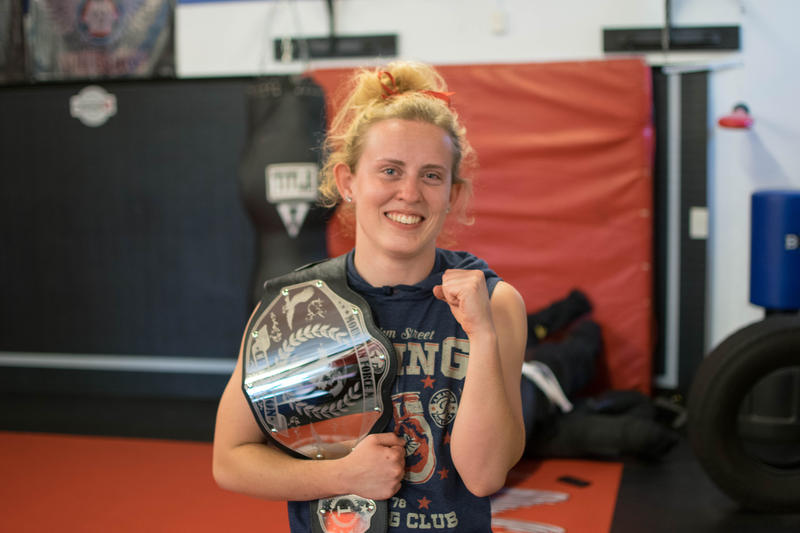 Kaycee Pearce stands with her Mountain Force MMA belt