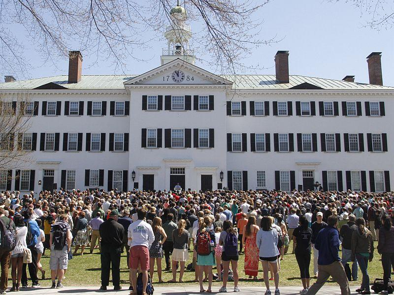 Dartmouth College students and faculty gather on campus to speak out after a group of students who staged a protest decrying homophobia, sexual assault and racism on campus were targeted by online threats.