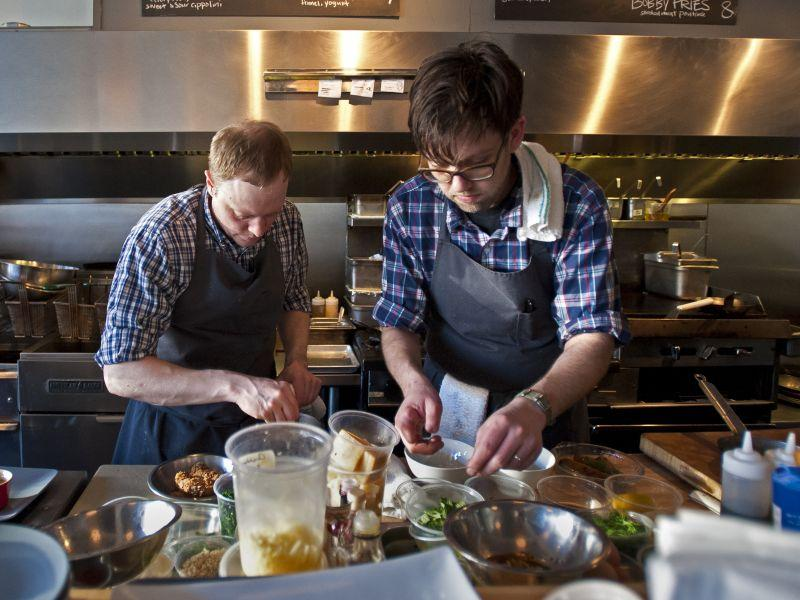Chefs Nathaniel Wade (left) and Aaron Josinsky cook at Misery Loves Company in Winooski