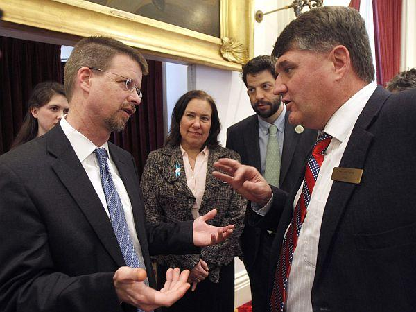 Speaker Shap Smith, left, debates with Minority Leader Don Turner, R-Milton.