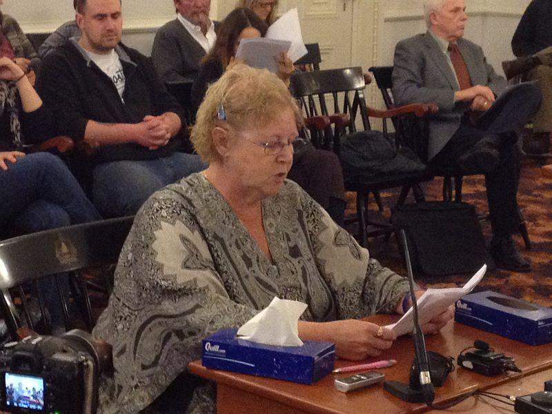 Rhonda Taylor, the mother of a Thetford man killed last June by a state police officer firing a stun gun, testifies before a legislative committee.