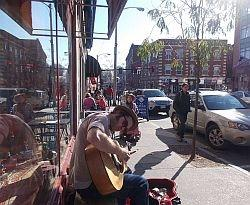 Guitarist Addison Rice performs on the sidewalk in downtown Brattleboro.