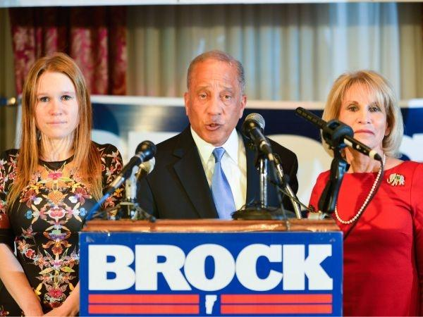 Republican gubernatorial candidate Randy Brock gives his concession speech alongside his daughter Natalia Brock, left, and wife