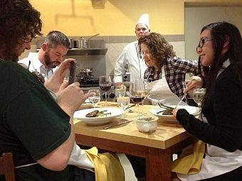 In a cooking class described by the chef as 'French comfort food,' participants enjoy their meal. Pictured eating are Ron and