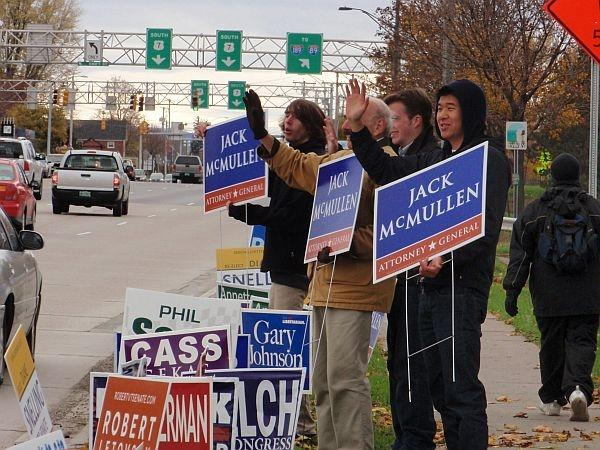 Attorney General candidate Jack McMullen waves to passing motorists during the last few days of the campaign.