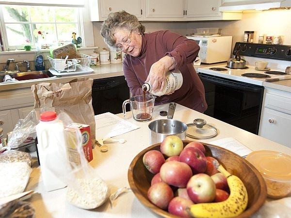 Ginger Isham prepares a variety of maple treats, including maple pudding, dumplings and granola, at her Williston home