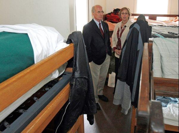 U.S. Rep. Peter Welch, D-Vt., left, views a sleeping dorm with Executive Director Kim Woolaver at the Good Samaritan Haven,