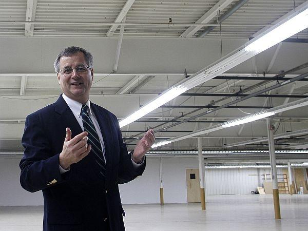 Todd Bachelder, new CEO of Menck USA, a German window company, leads a tour of the Newport facility where the business will locate.
