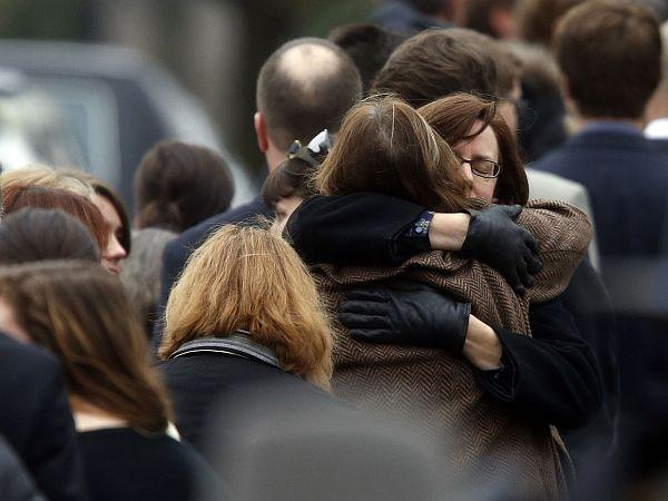 Mourners arrive at a funeral service for 6-year-old Noah Pozner, Monday, Dec. 17, 2012, in Fairfield, Conn. Pozner was killed