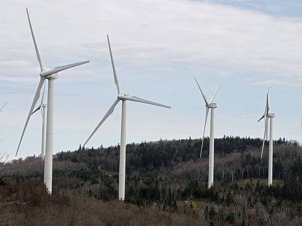 FILE- In this Oct. 26, 2011, file photo, wind turbines line the hillside at First Wind's project in Sheffield, Vt.