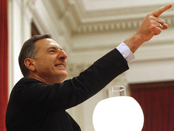 Gov. Peter Shumlin points to supporters during his inauguration to a second term on Thursday, Jan. 10, 2013 in Montpelier.