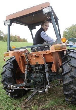 Matt Myers, coordinator of the Rollover Protective Structures program for the UVM Extension Service, sits in a tractor with a