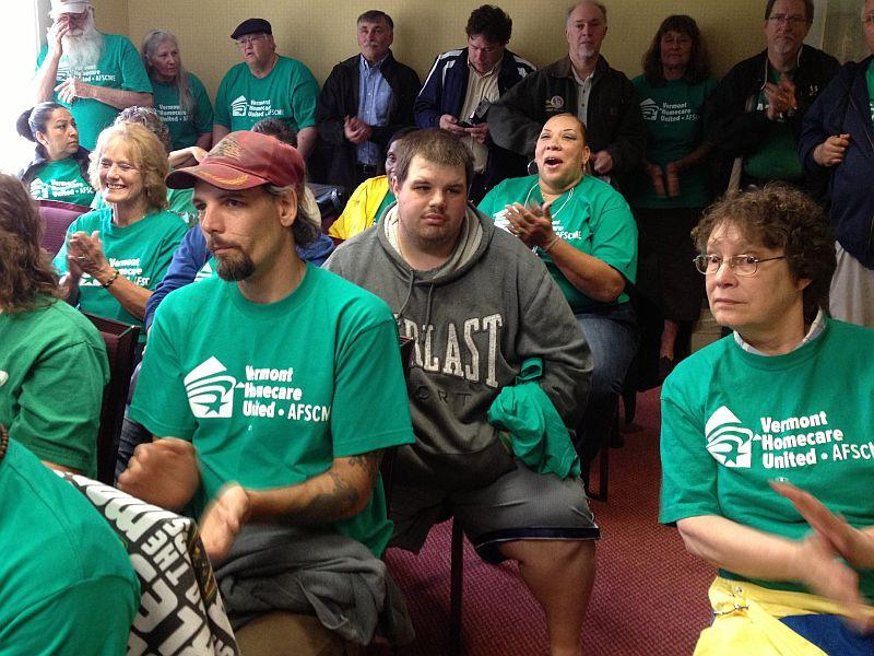 Dozens of home-care providers attended a rally in Montpelier before submitting petitions to organize a union.