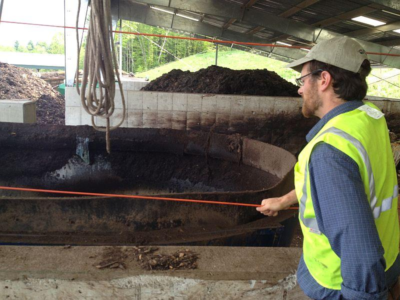 Dan Goossen, compost manager of the Chittenden Solid Waste District, looks over a giant blender that breaks down food scraps and other organic material for the composting process.