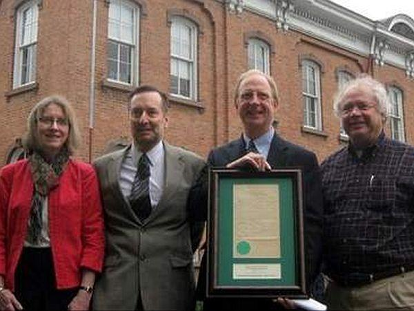 Pictured, from left, Molly Dillon, Merchants' president of trust and community banking; Robert Woolmington, president of the board for the Fund for North Bennington; Michael Tuttle, Merchants' president and CEO; and Paul Bruhn, Preservation Trust of Vt.