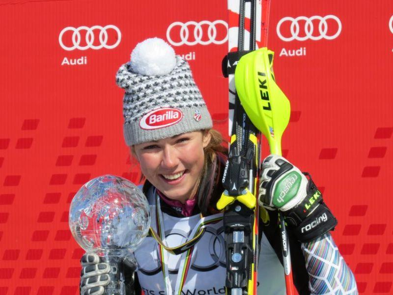 Mikaela Shiffrin accepts crystal trophy following victory at the World Cup Finals in Switzerland