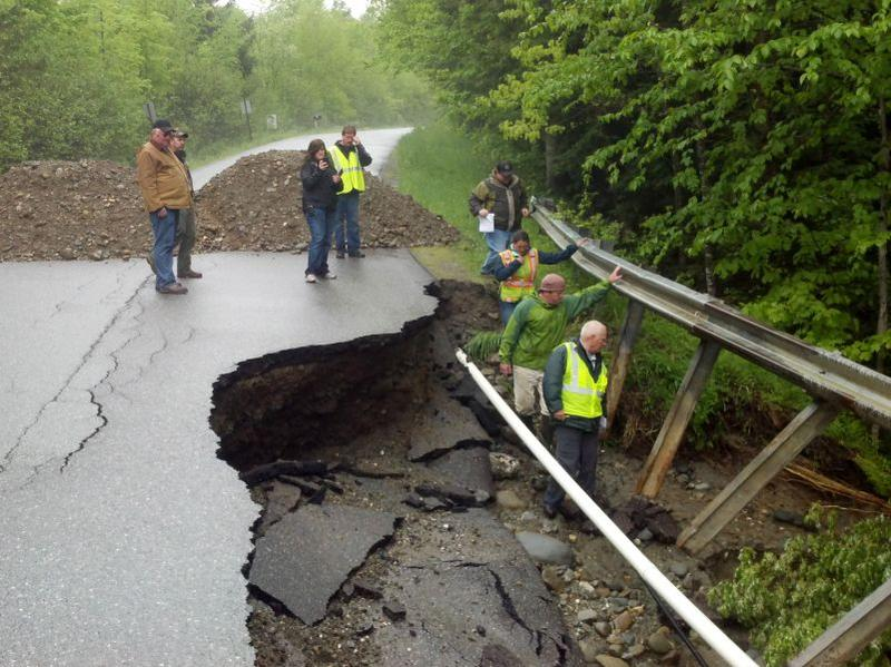 Officials inspect flood damage in Underhill, Vermont in 2013.