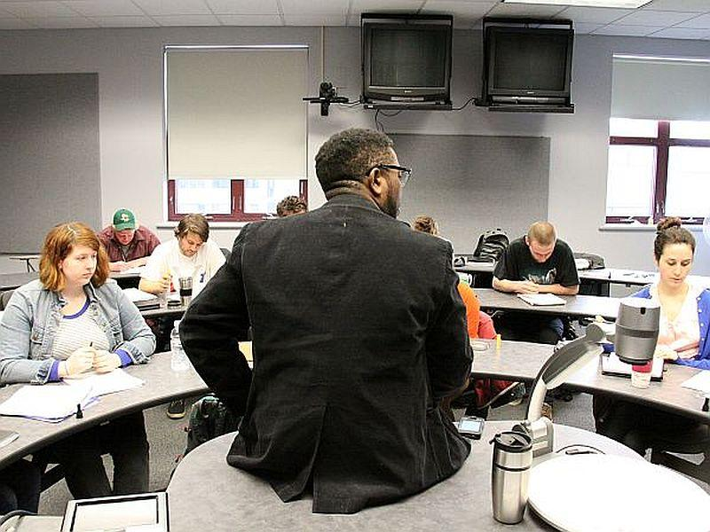 University of Vermont Professor Major Jackson teaches a poetry workshop on the Burlington campus. In the digital age, Jackson wants his students to appreciate the sound of words.