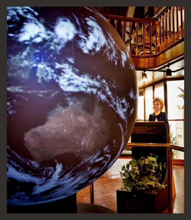 Phyler Holt, of St. Johnsbury, studies the OmniGlobe at the Fairbanks Museum.
