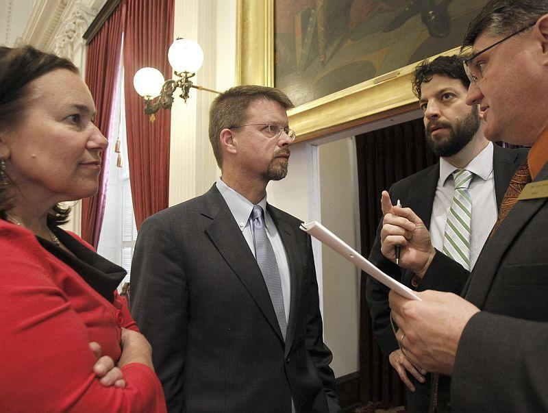 Speaker Shap Smith, second from left, confers with legislative leaders Rep. Tess Taylor, Chris Pearson and Don Turner.