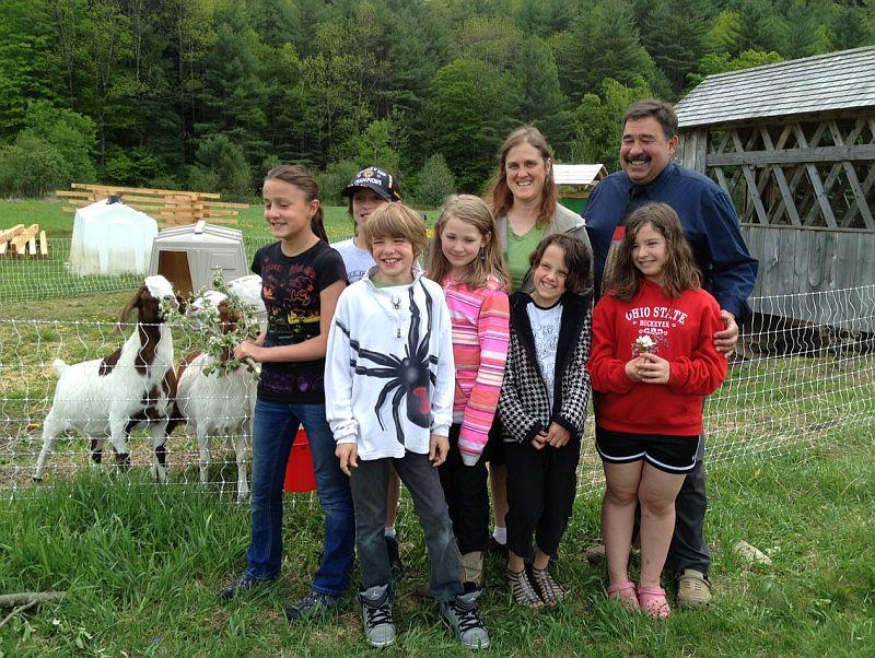 Fifth-graders at Reading Elementary School, teacher Patty Collins, and Principal Lou Lafasciano visit the school's goats.
