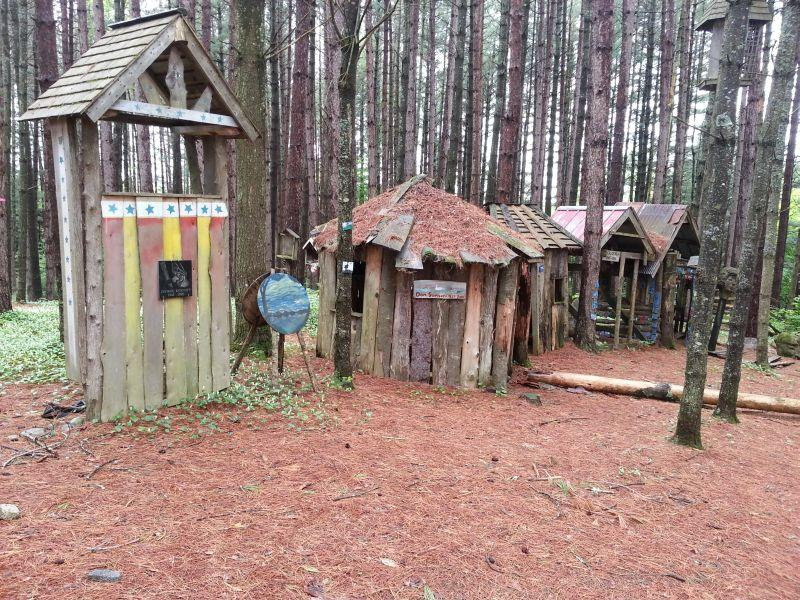 Memorial huts in the pine forest at Bread and Puppet's farm in Glover.