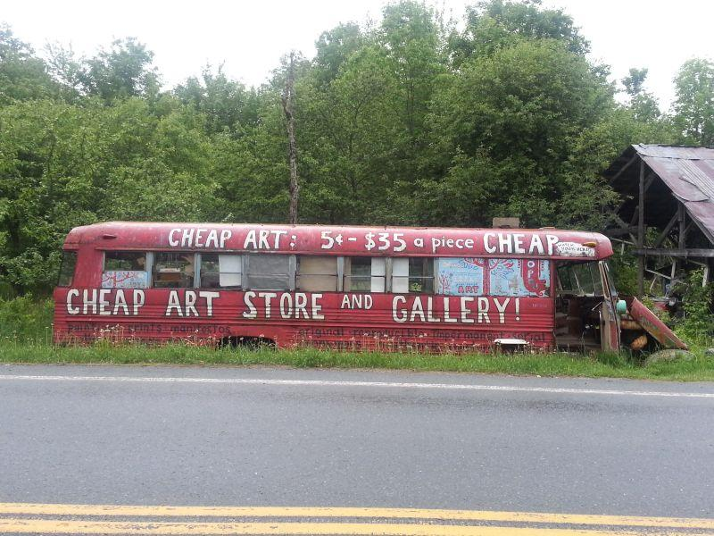"The ""Cheap Art Gallery"" is housed in an old school bus parked along Route 122 in Glover."