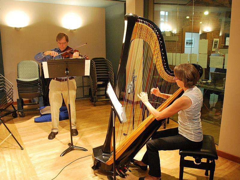 Kevin Lawrence and Rebecca Kauffman warm up prior to their live performance
