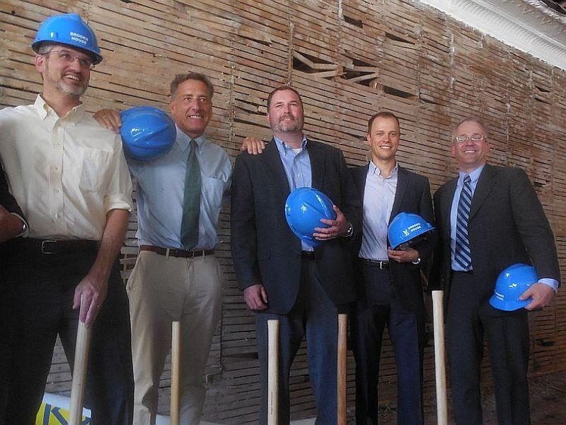 Gov. Peter Shumlin, second from left, with Bob Stevens, left, and members of the local development team that spearheaded the Brooks House project.