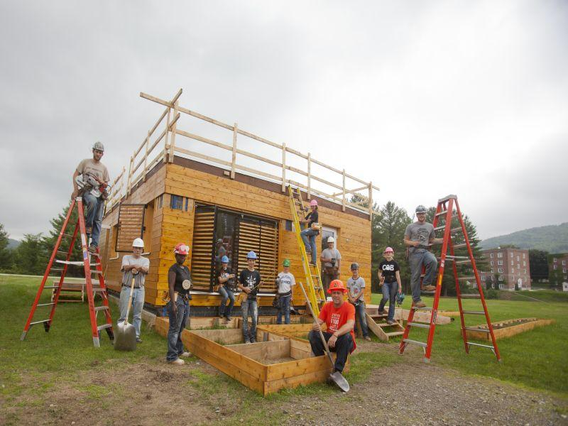 Members of the Delta T90 team putting the finishing touches on the solar house.
