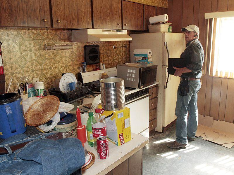 FEMA inspector Bruce Grass performs an assessment of the home of James Shene in September, 2011, in West Lyndonville, Vt.