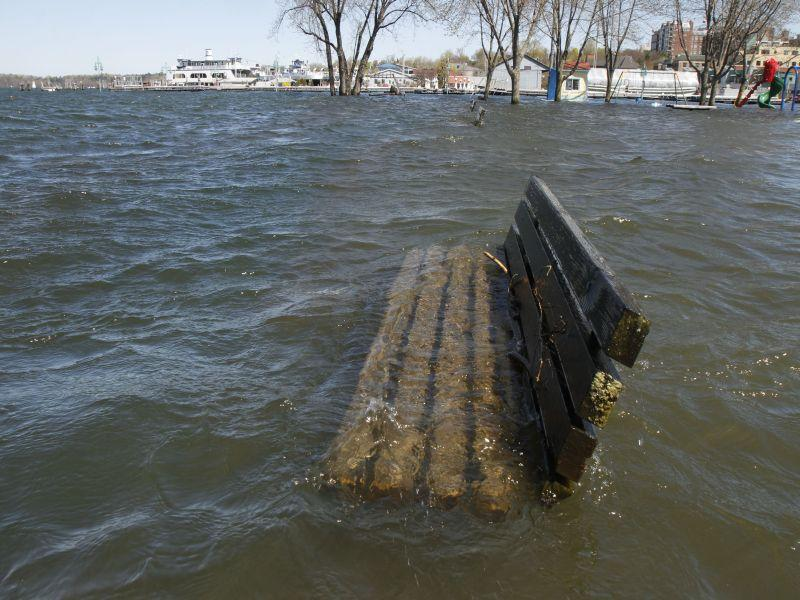 A park bench sits under water at the lakefront on Tuesday, May 10, 2011 in Burlington, Vt. The continued flooding of Lake Champlain could worsen pollution worries because of the high amount of phosphorus dumped into the lake from flooded farm fields.