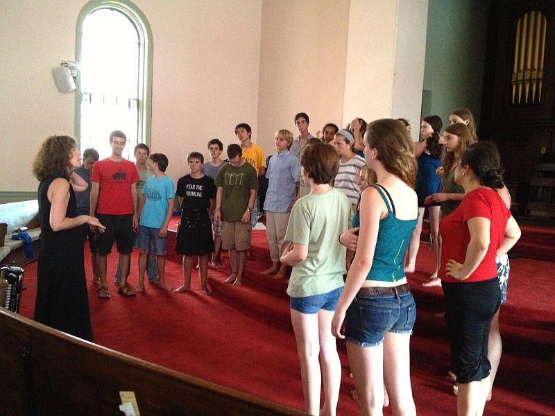 Patty Cuyler rehearses the Village Harmony chorus in Montpelier.
