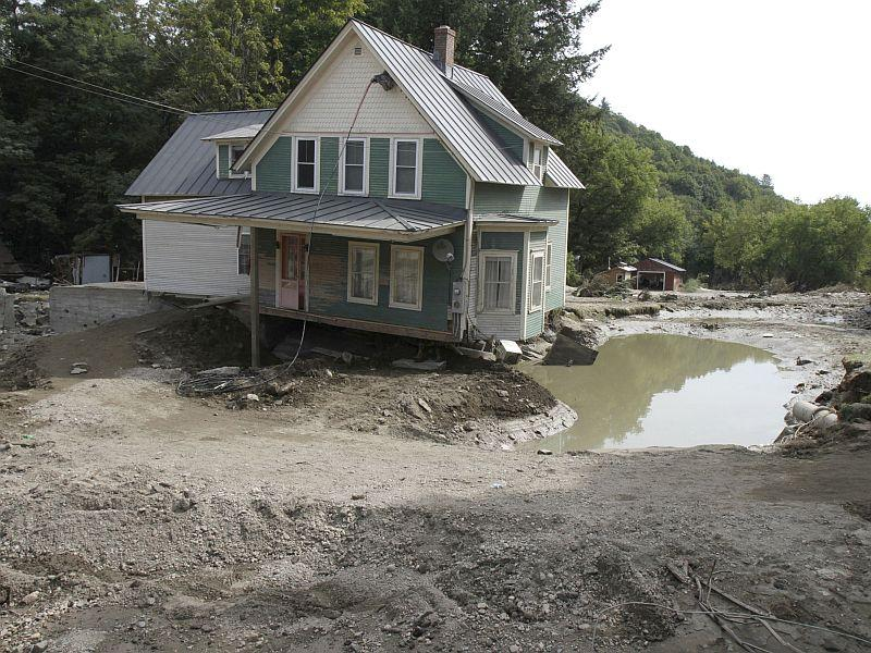 In this photo taken Aug. 31, 2011, a home sits with washed away property in Bethel