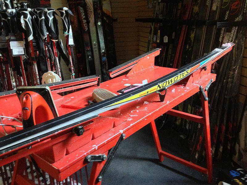 A skate ski clamped into a waxing bench