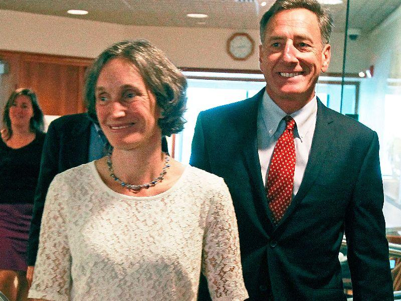 Rebecca Holcombe, left, walks with Gov. Peter Shumlin to a news conference on Thursday in Montpelier.