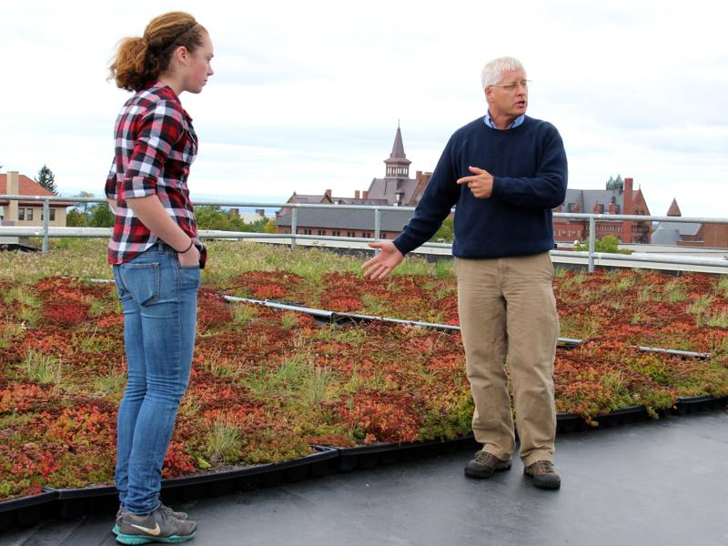"Professor Gary Hawley with his student Sam Wallace, explained the Aiken Center's ""green roof."""