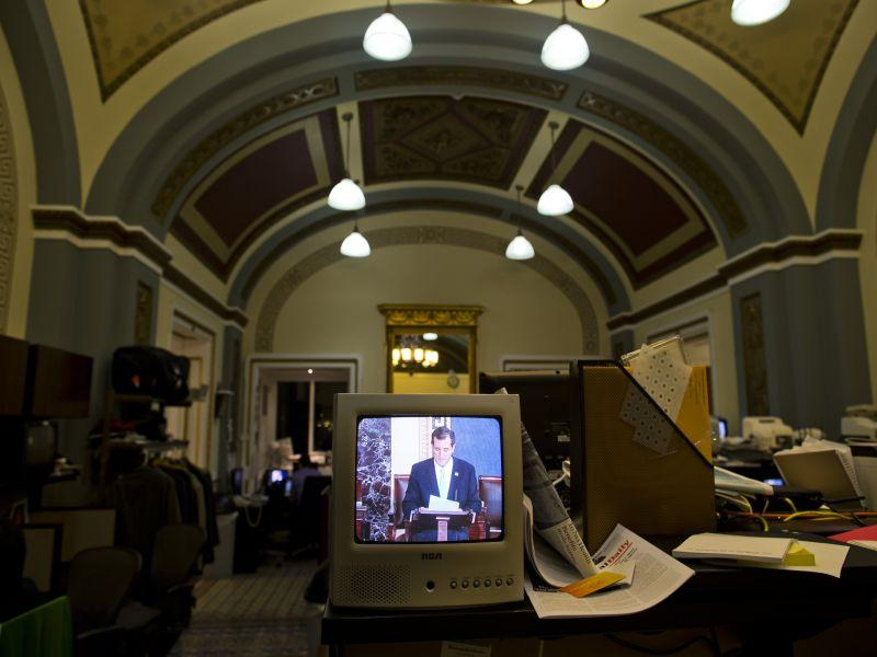 Sen. Ted Cruz, R-Texas, is seen on a television screen in the Senate Press Gallery during the tenth hour of his speech on the Senate floor on Wednesday, Sept. 25, 2013 in Washington.