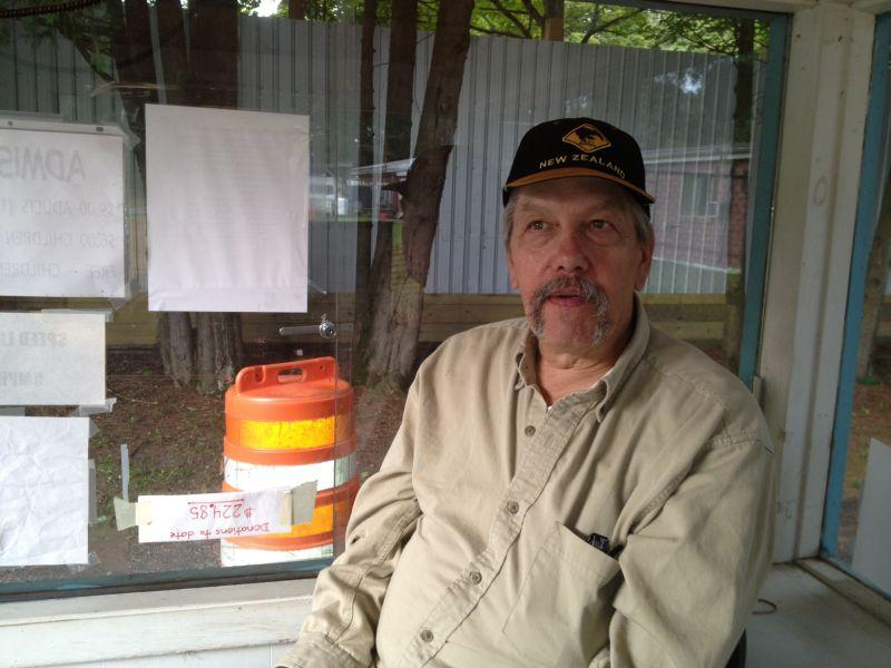 Peter Trapp ponders future of his Fairlee Drive-in at the ticket booth.