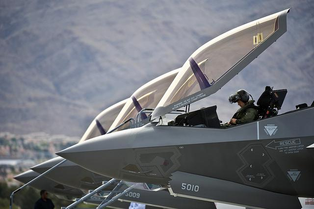 Capt. Brad Matherne conducts preflight checks inside an F-35A Lightning II before a training mission April 4 at Nellis Air Force Base, Nev.