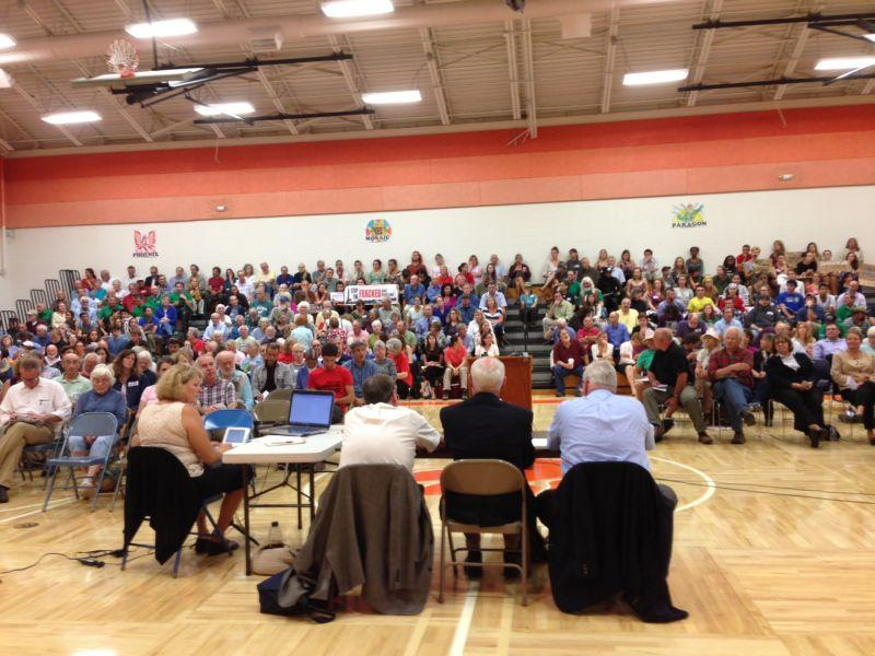 Hundreds of people crowded the Middlebury Middle School gym to attend the PSB hearing