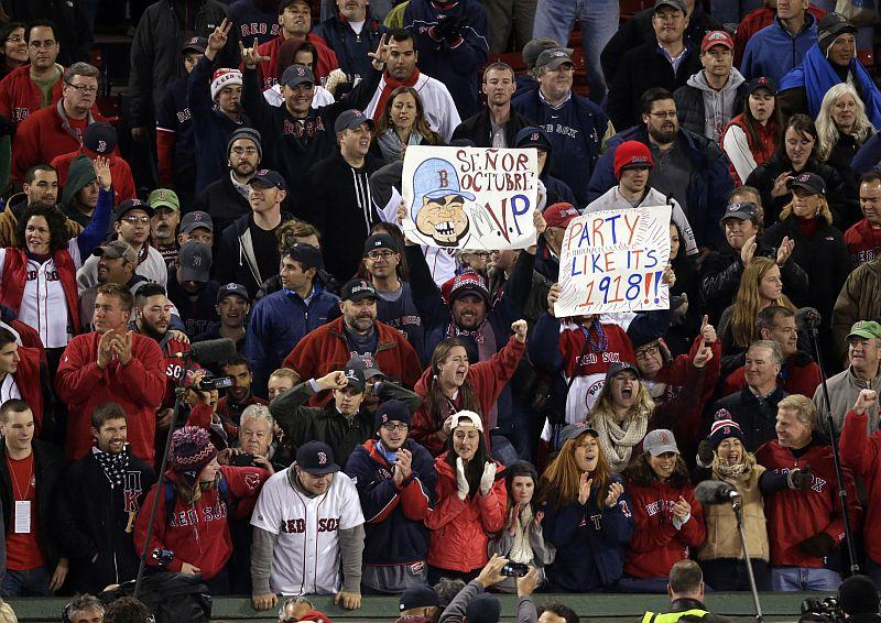 Boston Red Sox fans celebrate after Boston defeated the St. Louis Cardinals in Game 6 of baseball's World Series.