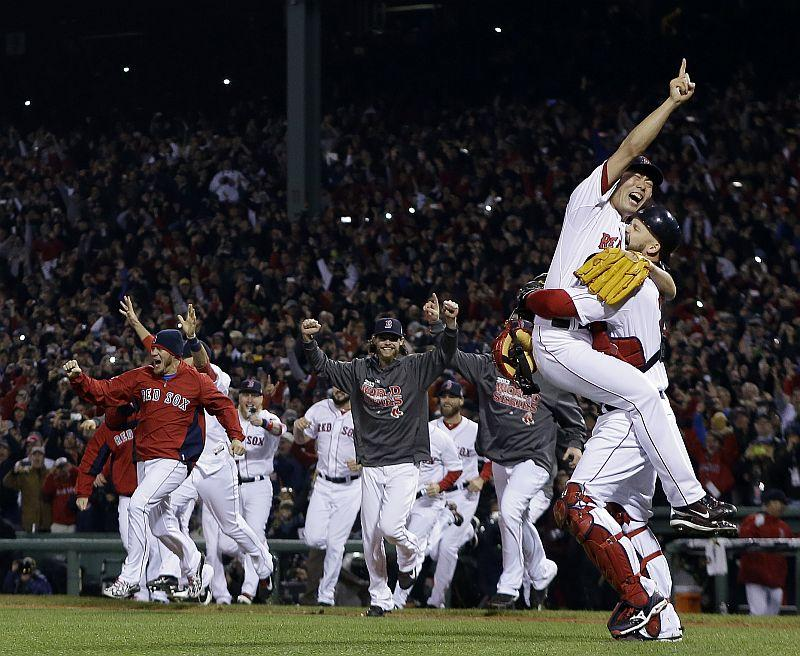 Boston Red Sox relief pitcher Koji Uehara and catcher David Ross celebrate after getting St. Louis Cardinals' Matt Carpenter to strike out and end Game 6 of baseball's World Series.