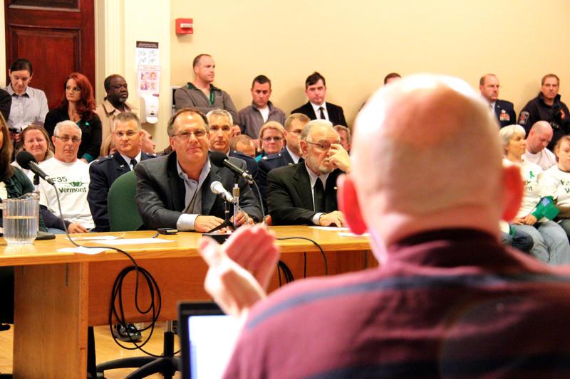 Vince Brennan questioning Gene Richards, the director of aviation at Burlington International Airport.