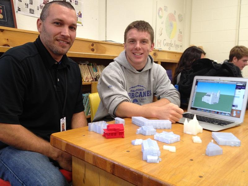 Hartford High School teacher Mike Hathorn and student Nolan Viens display 3-D buildings printed for part of a research project