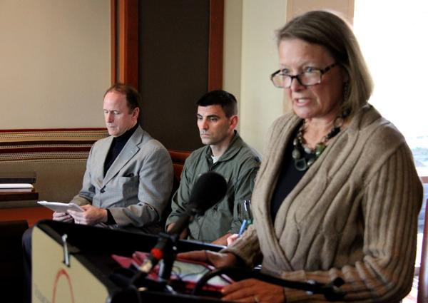 Lisa Ventriss of the Vermont Business Roundtable, right, at a press conference with Vermont Air National Guard Lt. Col. Chris Caputo, center, and Frank Cioffi, president of the Greater Burlington Industrial Corporation.