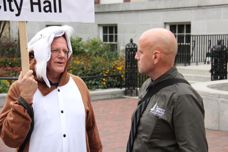 Ben & Jerry's co-founder Ben Cohen protested in a guinea pig costume. Burlington City Councilor Vince Brennan opposes the F-35, but stuck to a shirt and tie in coming to the protest.
