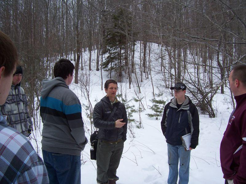 Luke Foley (center), with students and school principa,l Ryan Parkman, discussing projects in the school forest