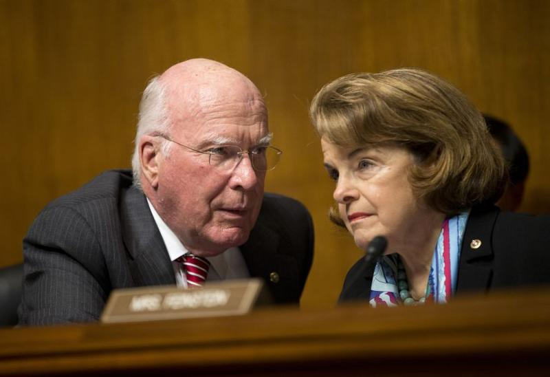 Senate Judiciary Committee Chairman Sen. Patrick Leahy, left, talks with Sen. Dianne Feinstein, on Capitol Hill in Washington, Oct. 2, 2013, during the committee's oversight hearing on the Foreign Intelligence Surveillance Act.