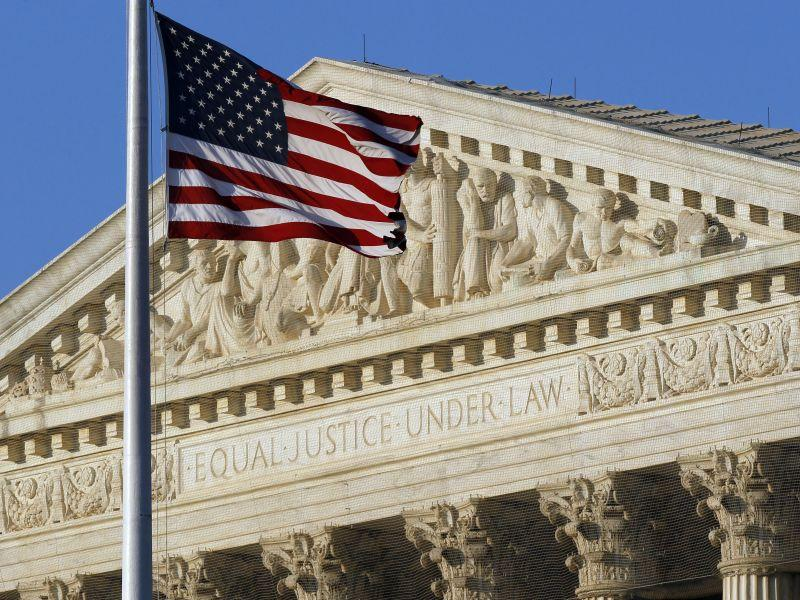 An American flag flies in front of the U.S. Supreme Court